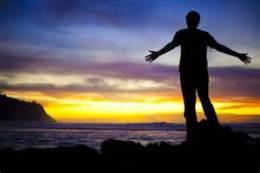 man rejoices sundown