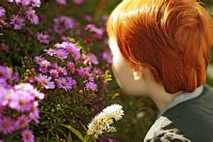 smelling the flowers.