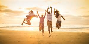 happy people jumping into sunrise