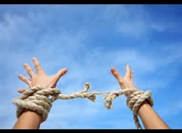 Torn rope as bonds broken arms to sky